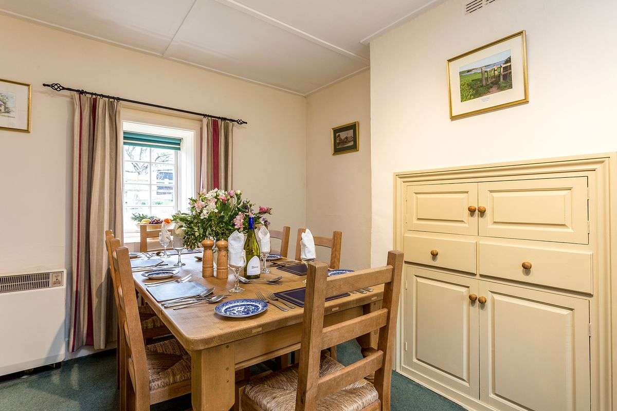 Family dining in Dorset cottage